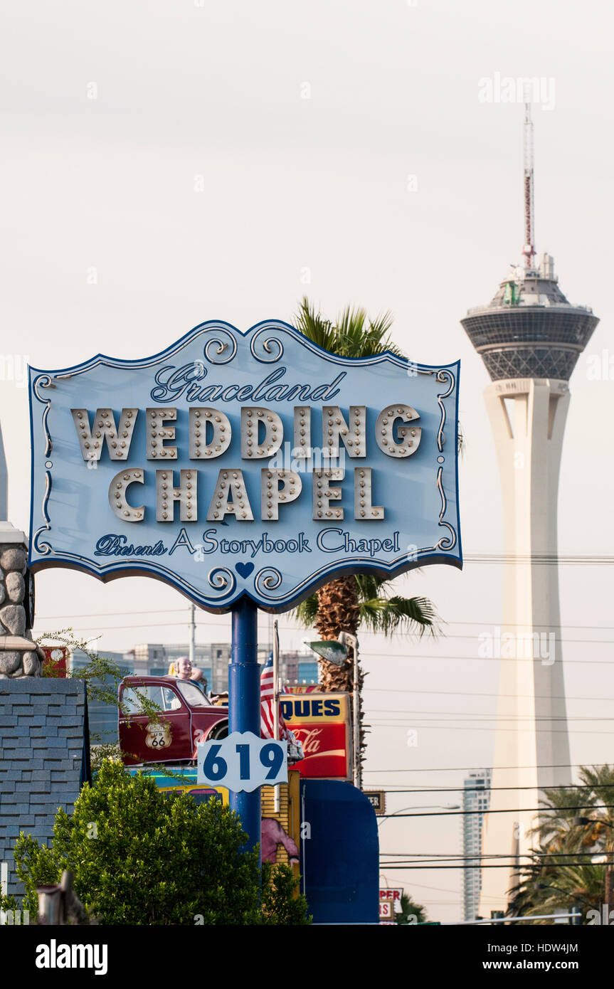 The Graceland Wedding Chapel with the Stratosphere Tower, Las Vegas, Nevada. - Stock Image