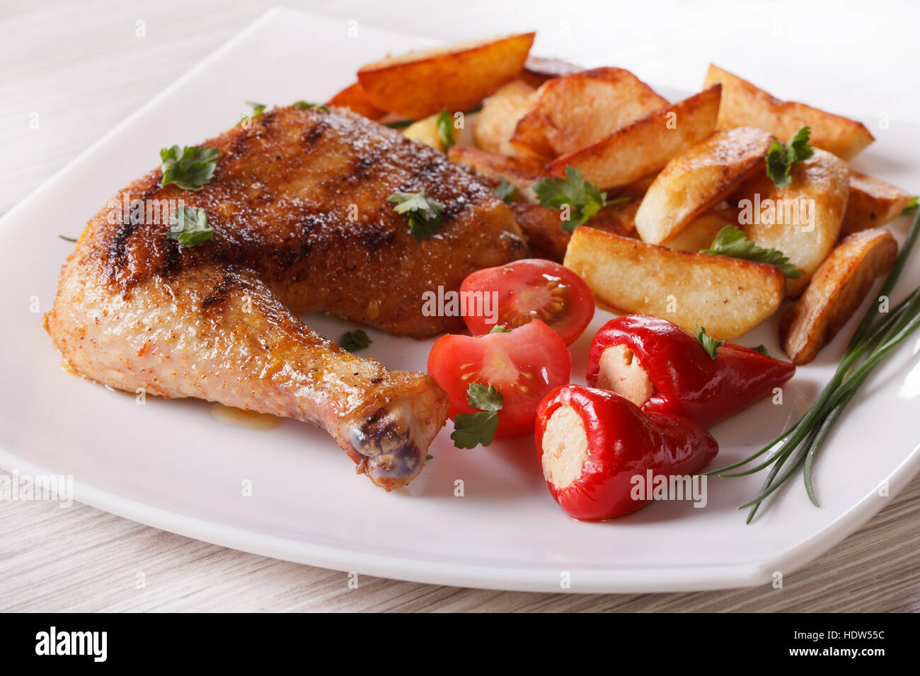 Grilled Chicken Leg Roasted Potatoes And Vegetables On A Plate