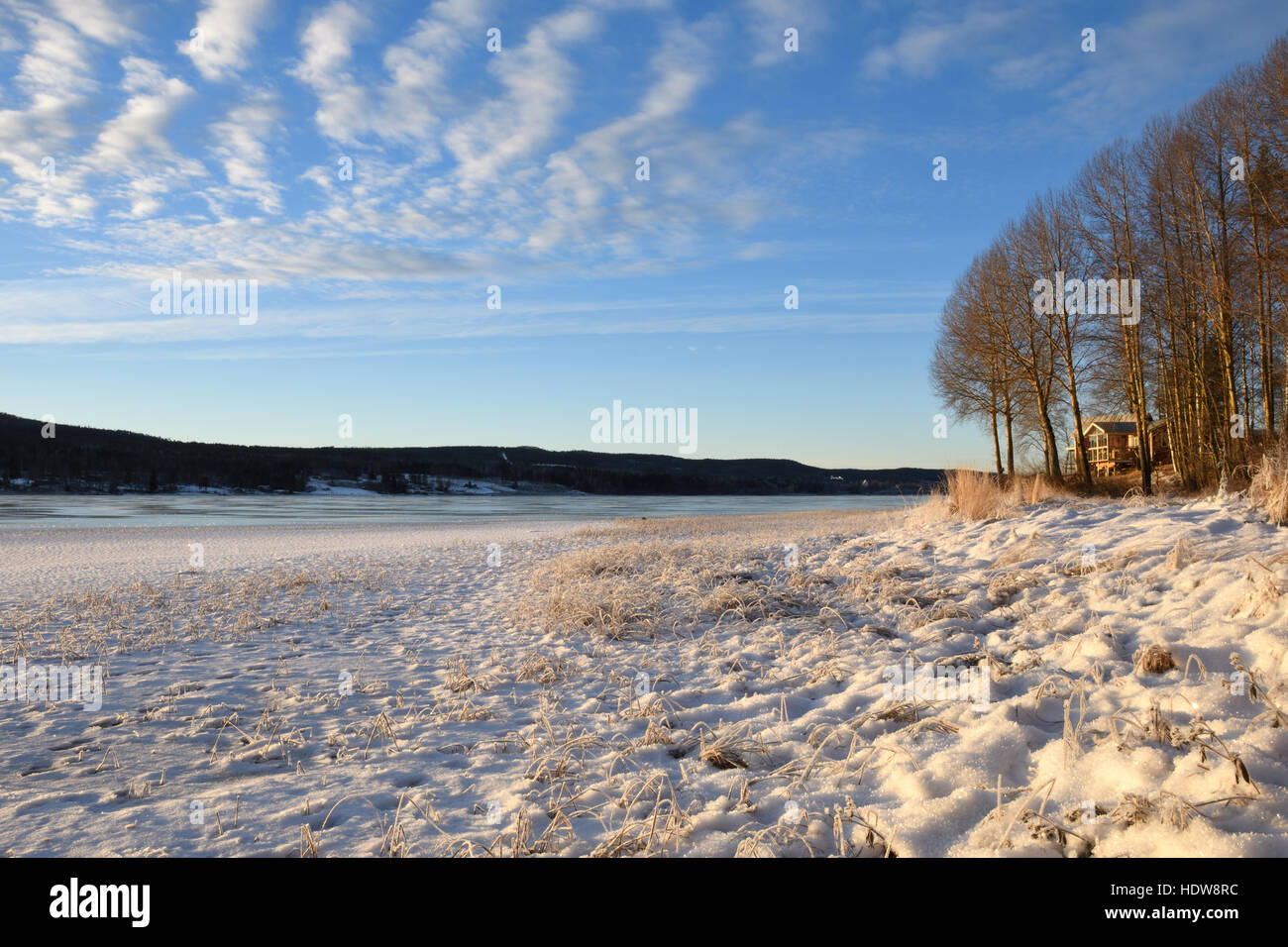 Sea Shore With Snow And Mountain In Background And Blue Sky With Some  Clouds, Picture
