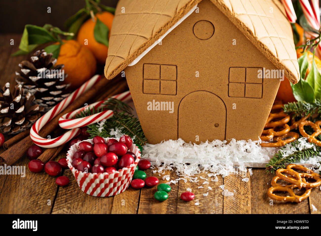 Gingerbead house ready to be decorated with candy - Stock Image