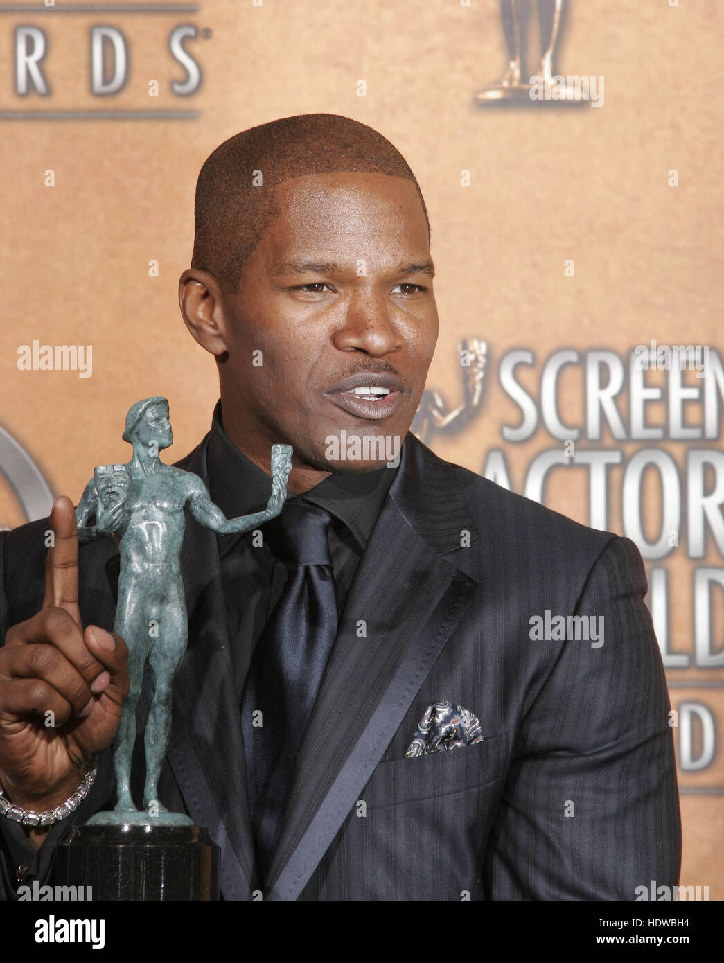Jamie Foxx holds the award for outstanding performance by a male actor in a leading role for his work in 'Ray,' - Stock Image