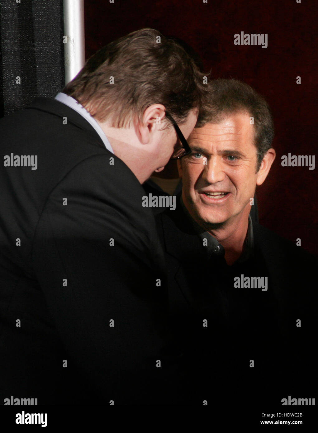 Directors Mel Gibson, right, and Michael Moore have a chat backstage at the People's Choice Awards in  Pasadena, - Stock Image