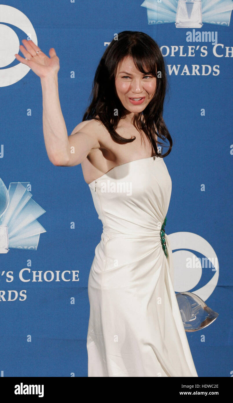 Actress RenÈe Zellweger waves backstage after winning an award for best actress at the People's Choice - Stock Image