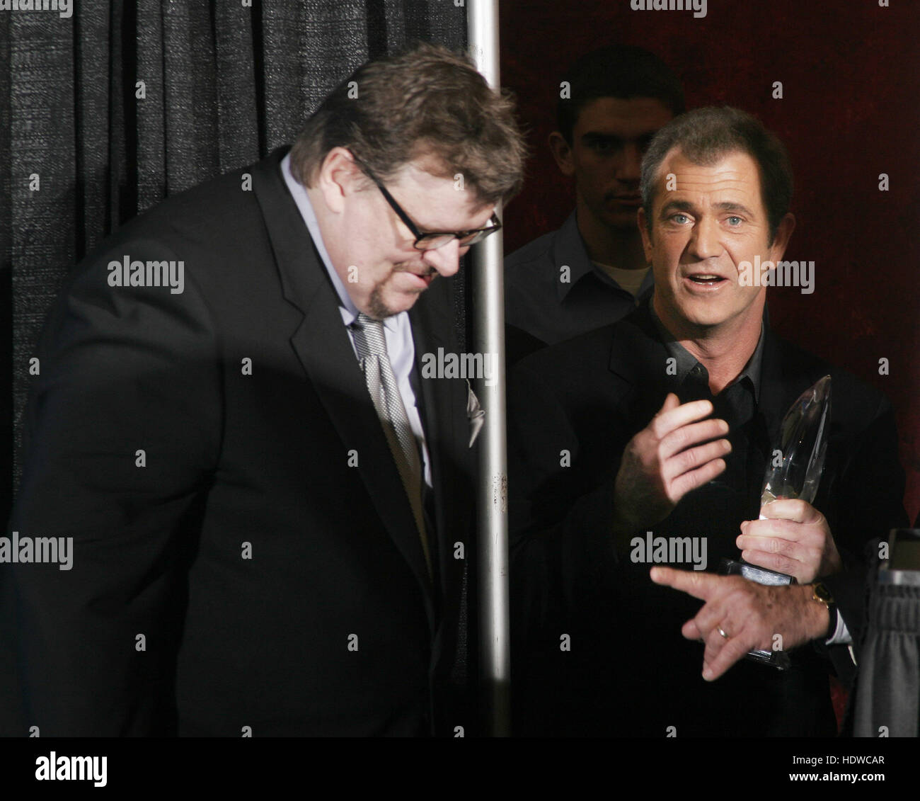 Michael Moore, left, and Mel Gibson meet backstage at the People's Choice Awards in Pasadena, California on - Stock Image