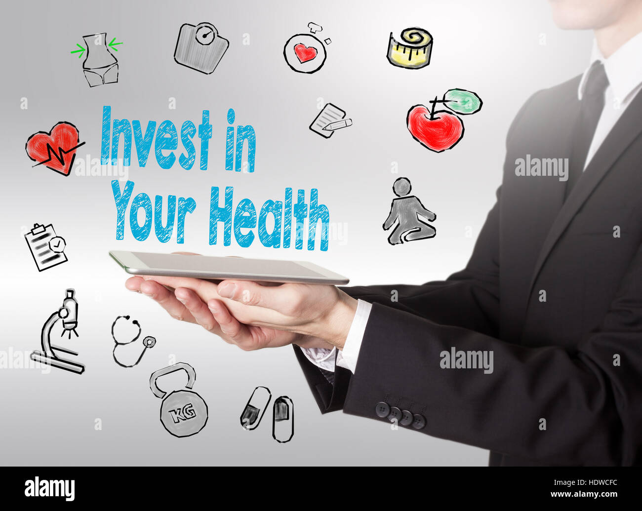 Invest in your health concept. Healty lifestyle background. Man holding a tablet computer. Stock Photo
