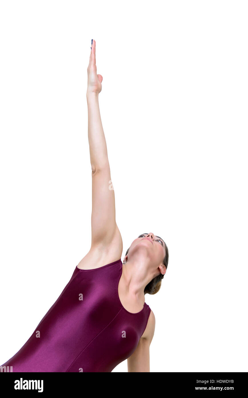 Pretty young woman practicing yoga at side plank on the knee pose in the studio - Stock Image