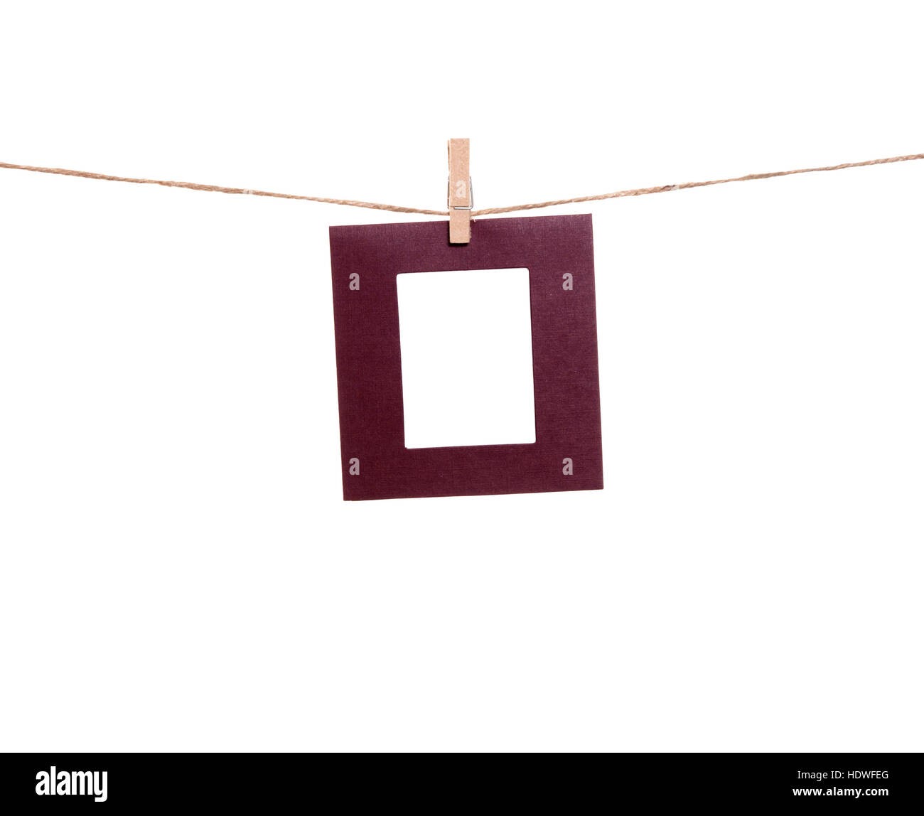 Blank photo frames hanging by clothespins on a rope. You can put ...