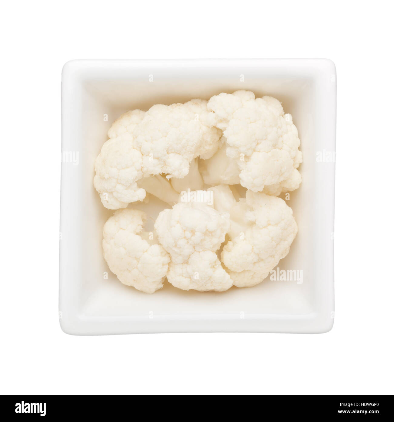 Cauliflower in a square bowl isolated on white background - Stock Image