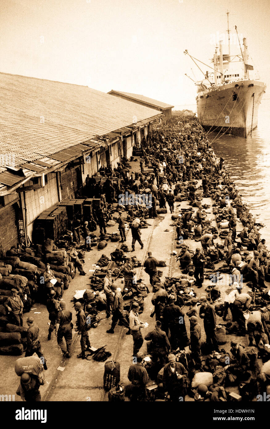 U.S. troops are pictured on pier after debarking from ship, somewhere in Korea. Stock Photo