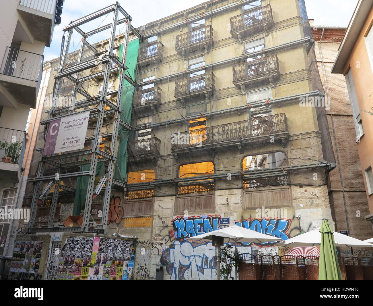 Steel structure shoring up old building in Valencia, Spain - Stock Image