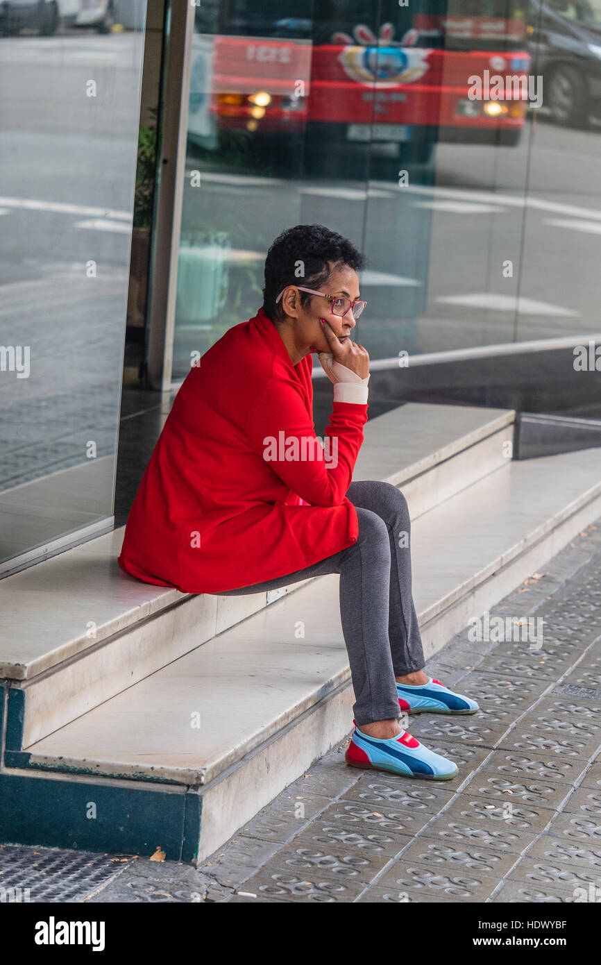 A Spanish female dressed in a red jacket and fancy running shoes and  tights 972ccfe35