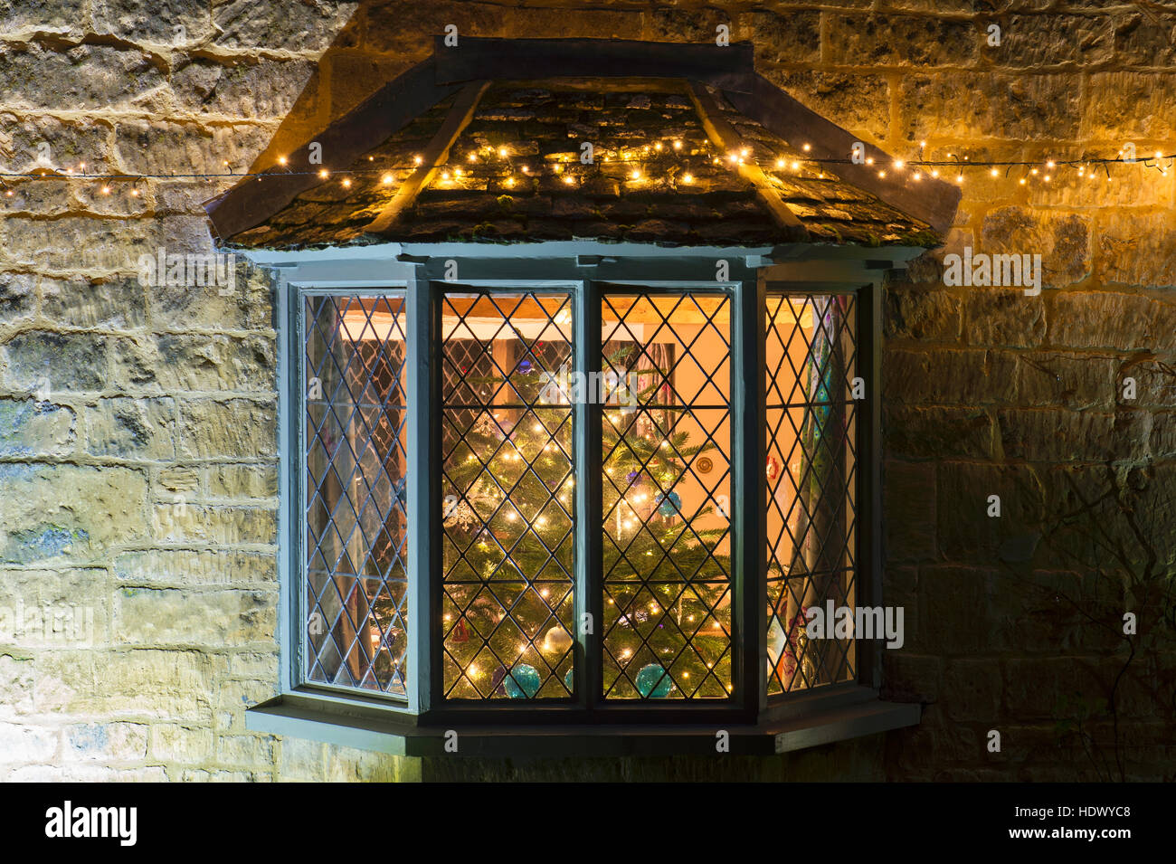 Bay Window and a christmas tree with lights inside a cottage in ...