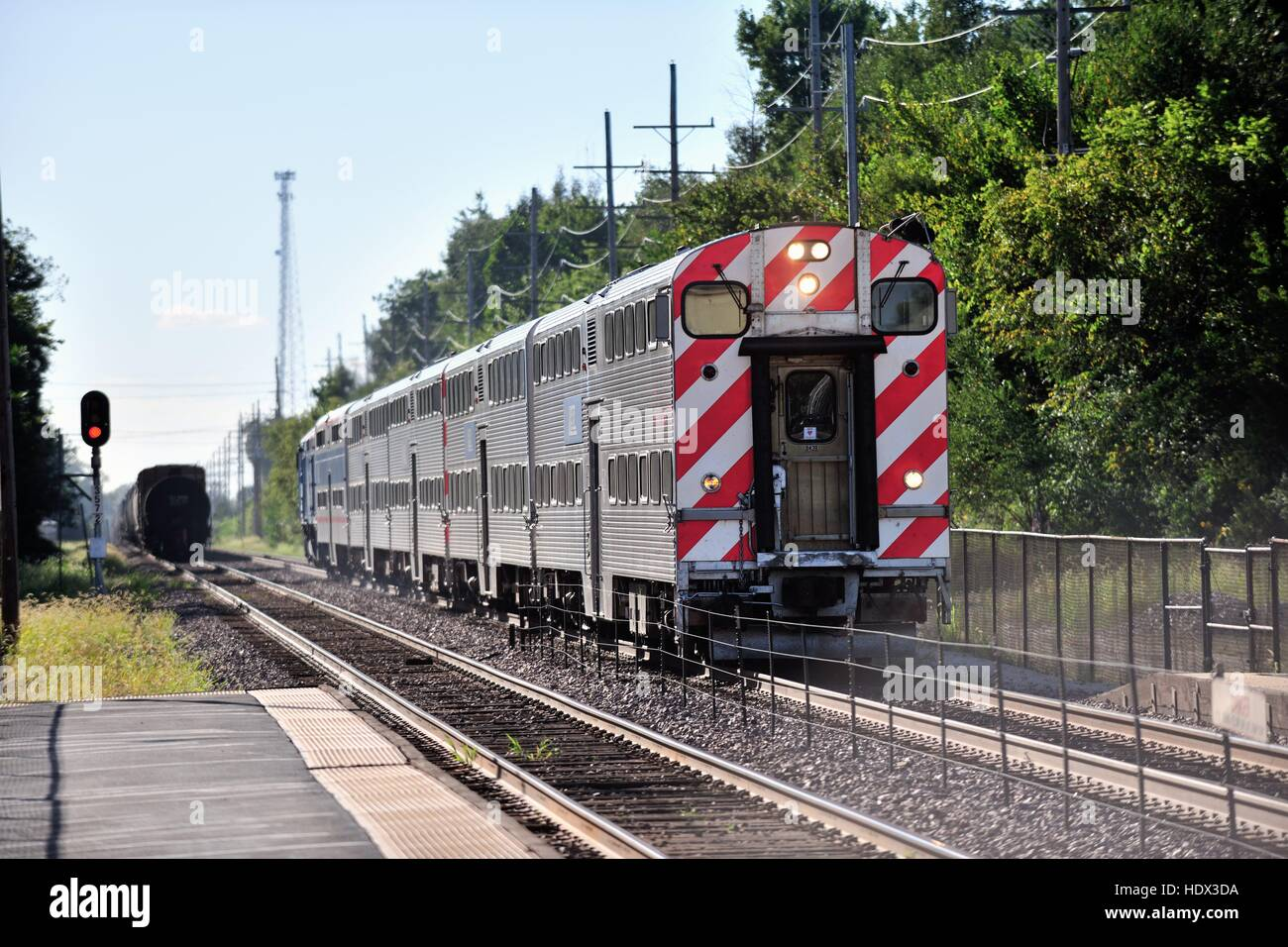 A Metra commuter train, using push-pull techniques arriving at Geneva, Illinois on its way to Chicago. Geneva, Illinois, - Stock Image