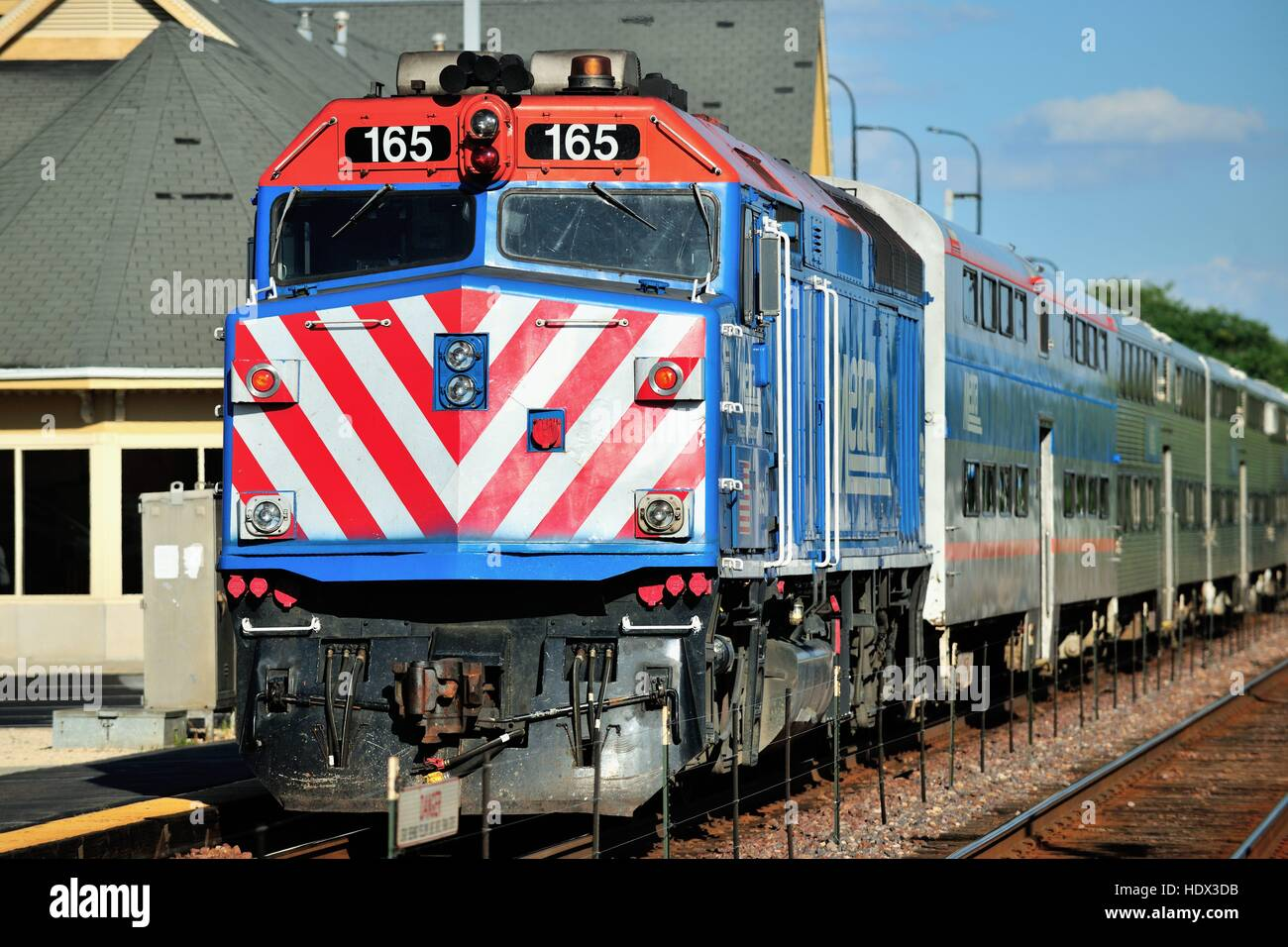 A Metra commuter train, using push-pull techniques arriving at Geneva, Illinois on its way to Chicago. - Stock Image