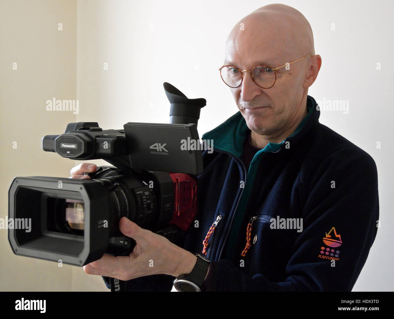 Clive Tully FRGS holding Panasonic AG-DVX200 professional video cameraStock Photo