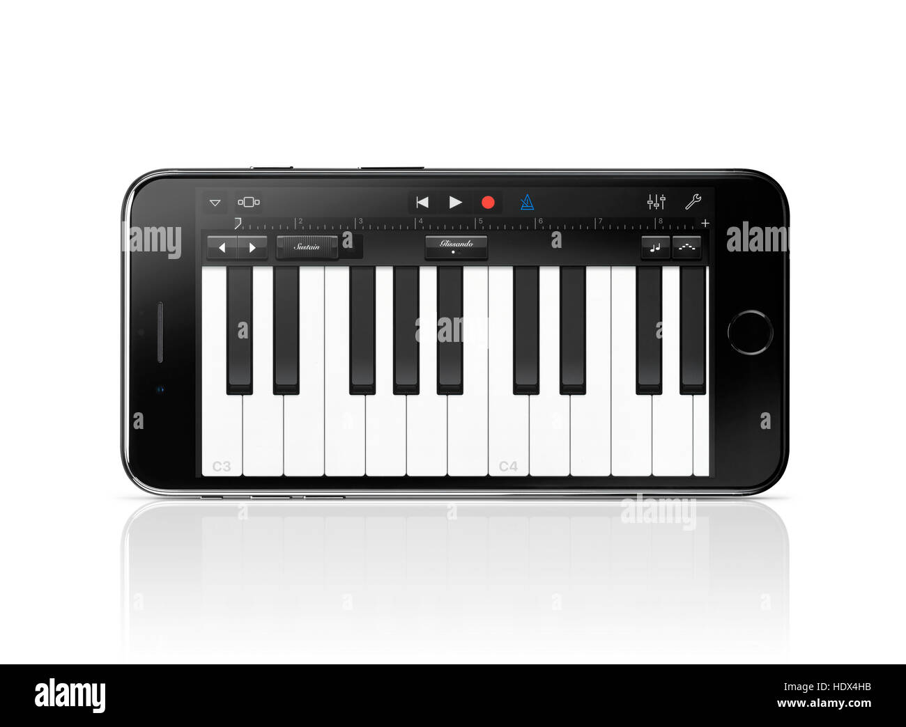 Apple iPhone 7 Plus with piano keyboard Garage Band Apple music app on its display isolated on white background - Stock Image