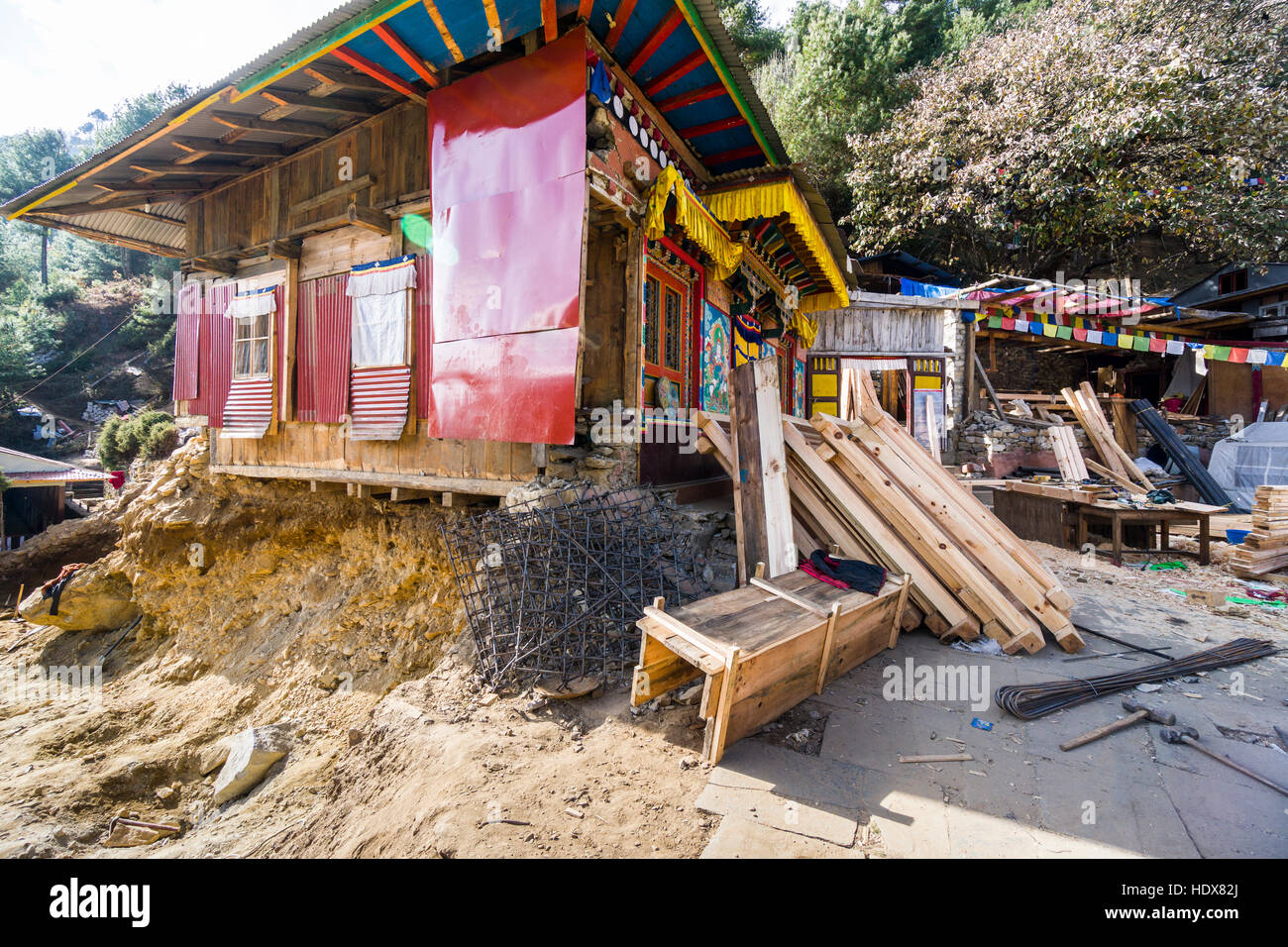 The monastery Pema Choling Gompa, which was heavily damaged during the 2015 earthquake, is getting rebuild - Stock Image
