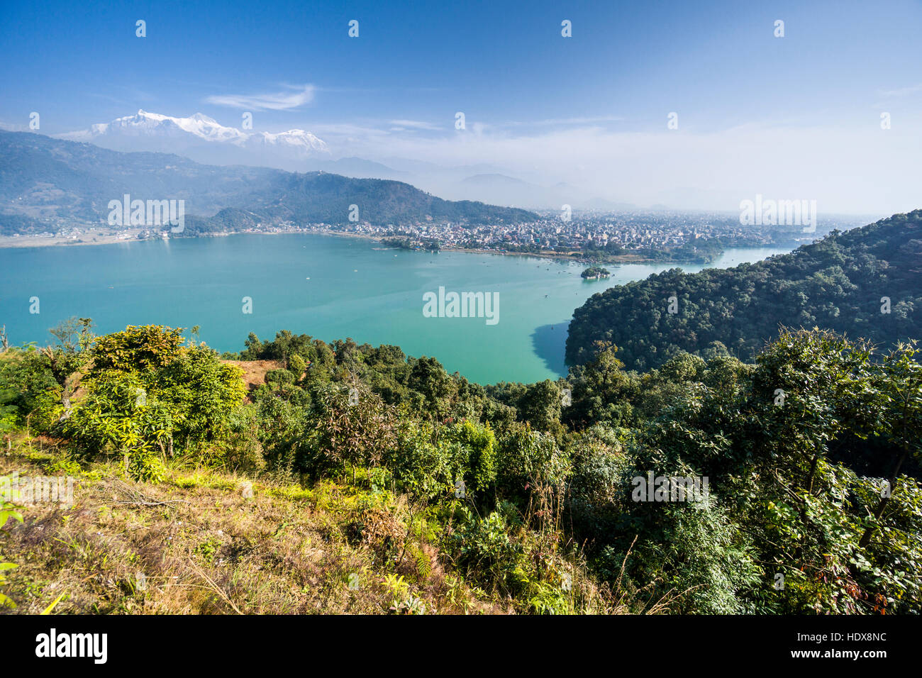 Aerial view on Phewa Lake and Pokhara Lake Side, Annapurna mountains in the distance - Stock Image