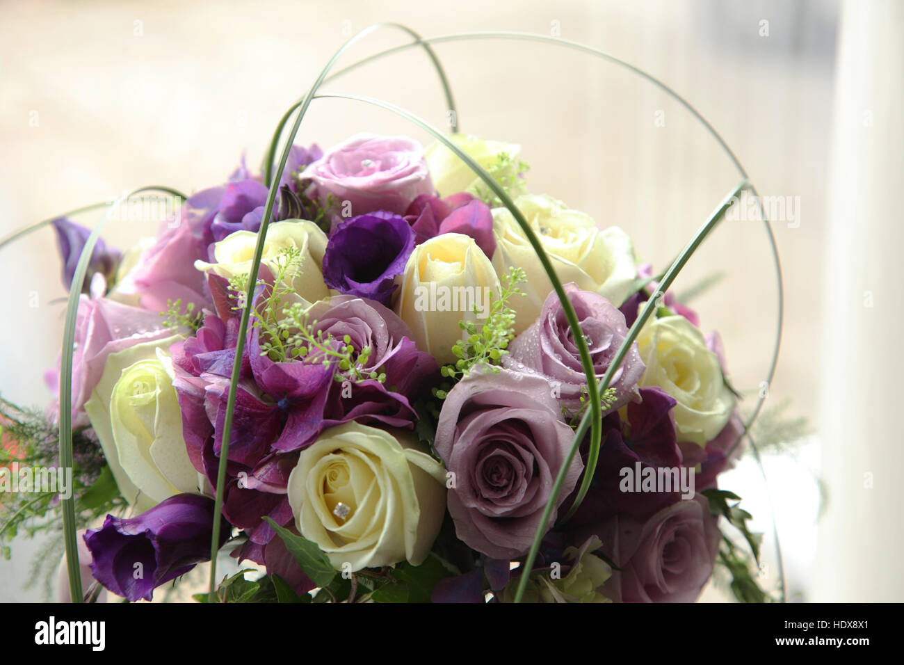 A Wedding Bouquet Made Of Roses In Dusky Pink Magenta And Cream