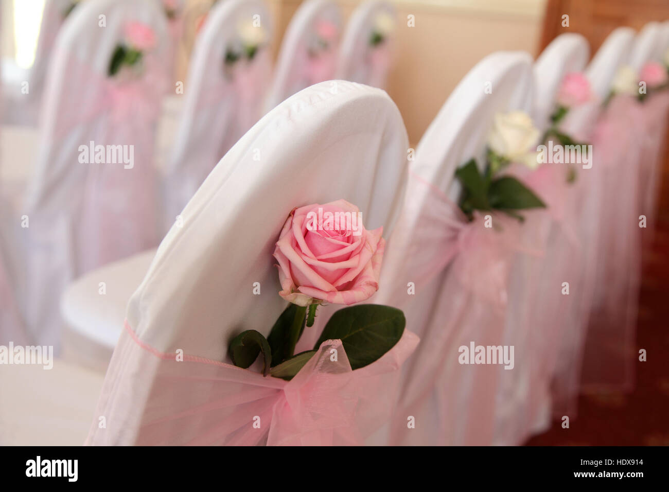 Stupendous Chairs Decorated With White Covers And Pink And White Roses Theyellowbook Wood Chair Design Ideas Theyellowbookinfo