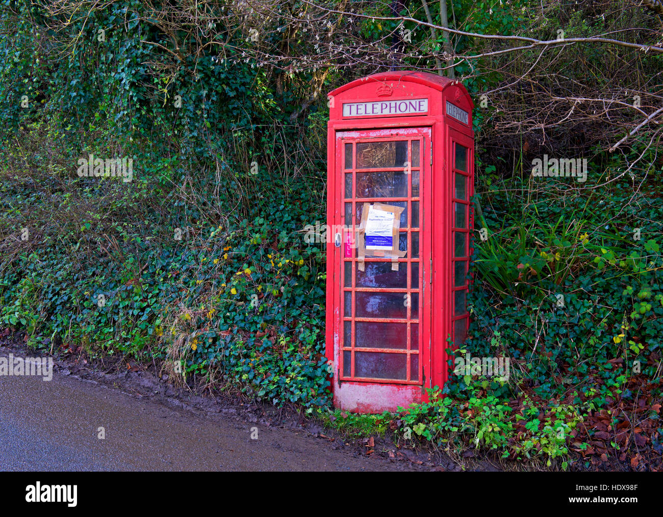 Sign notifying public that this telephone box will be removed, England UK - Stock Image