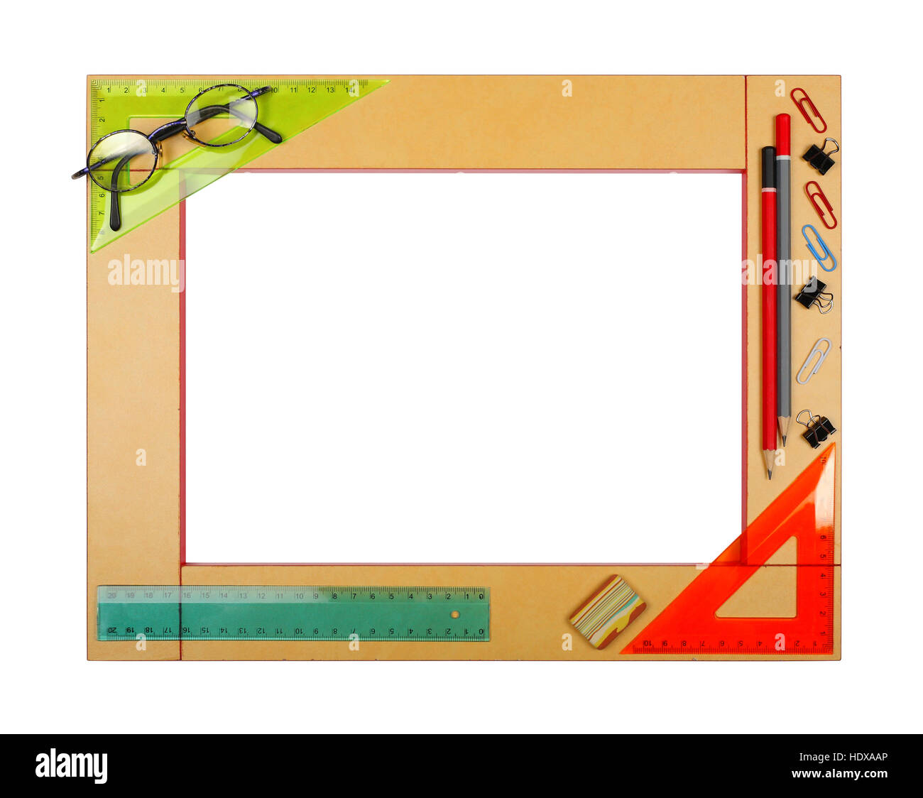 Yellow art school frame with stationery - ruler, square, protractor ...