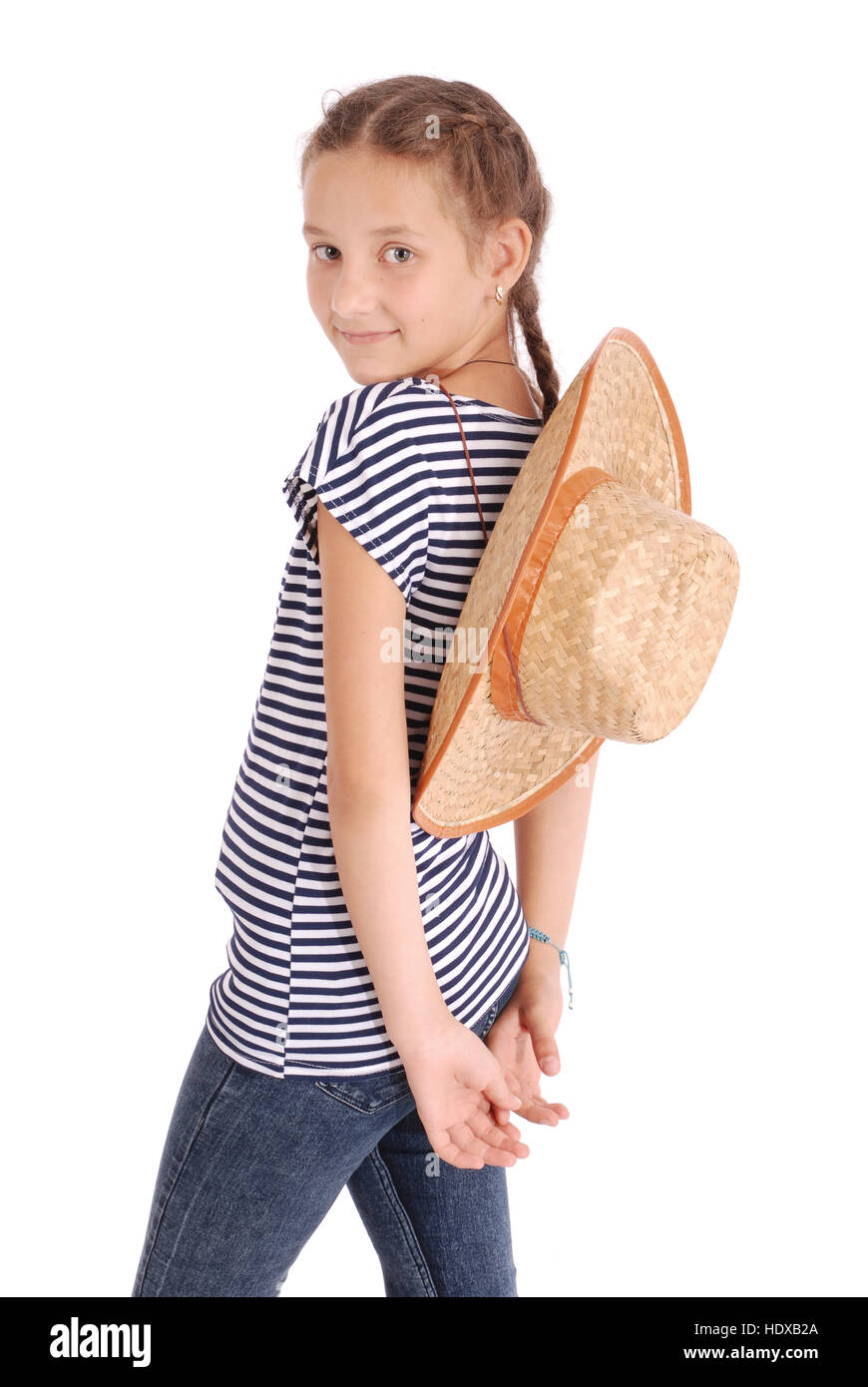 d601ee8cf82 Pretty twelve year old girls wearing a big floppy straw sun hat isolated on  white -