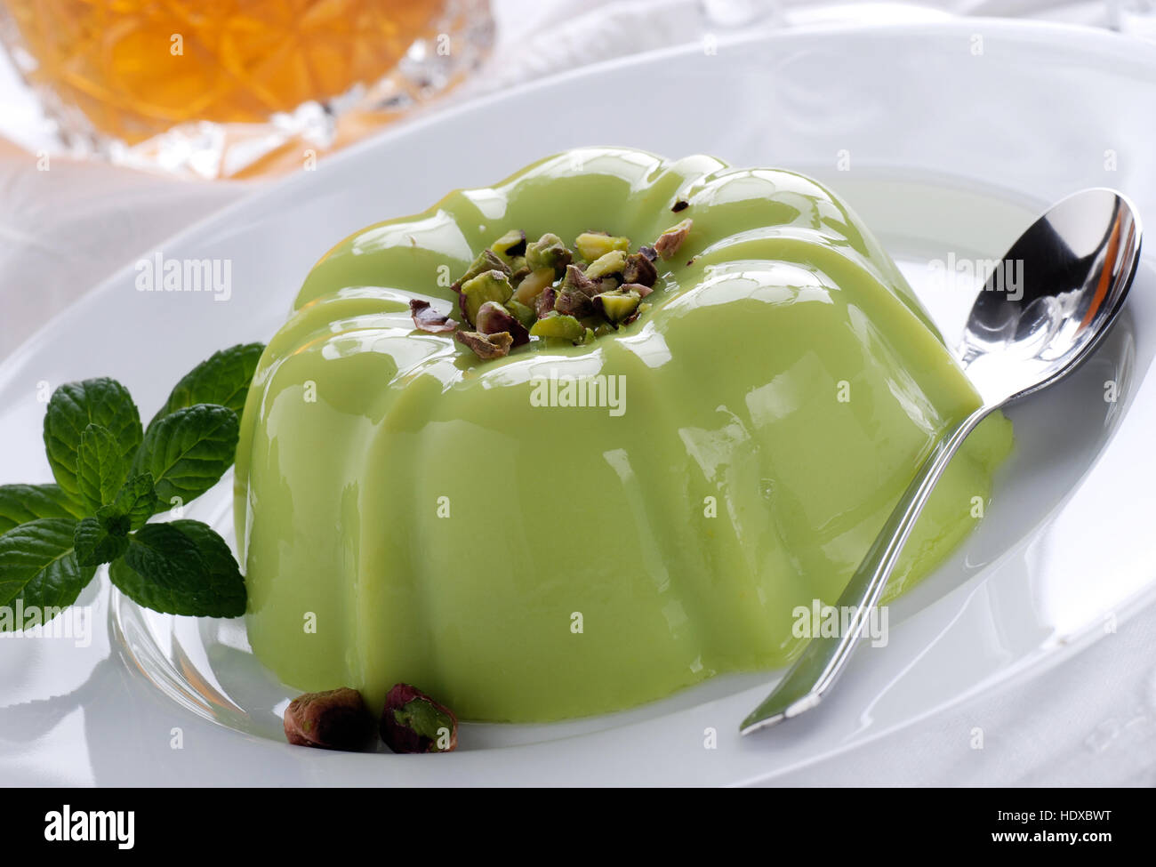 pistachio pudding on white plate - Stock Image
