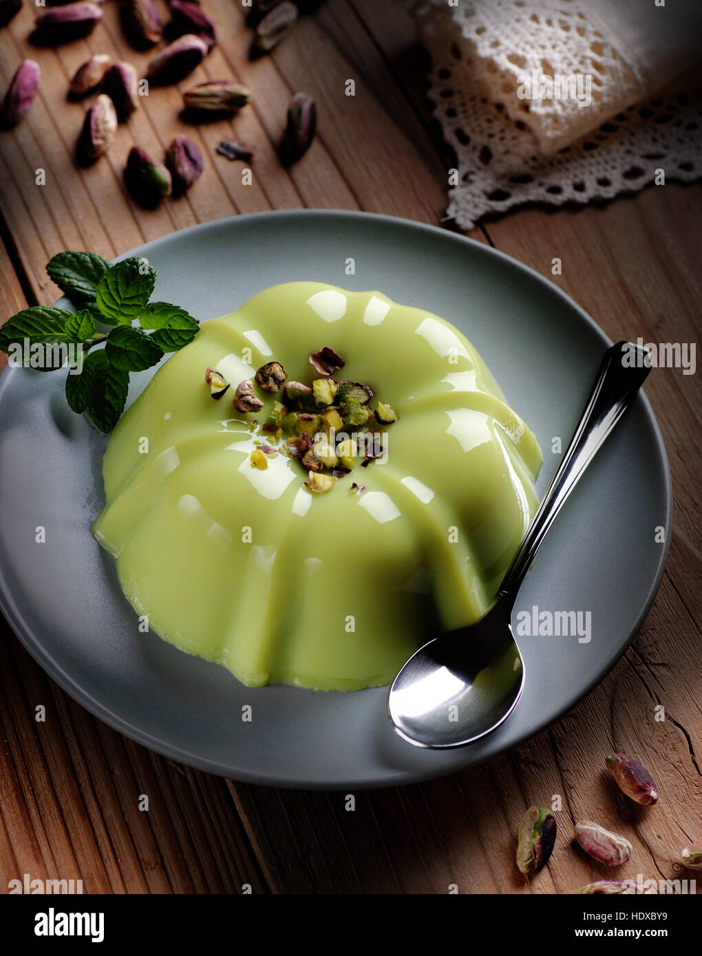 pistachio pudding with ingredients around - Stock Image