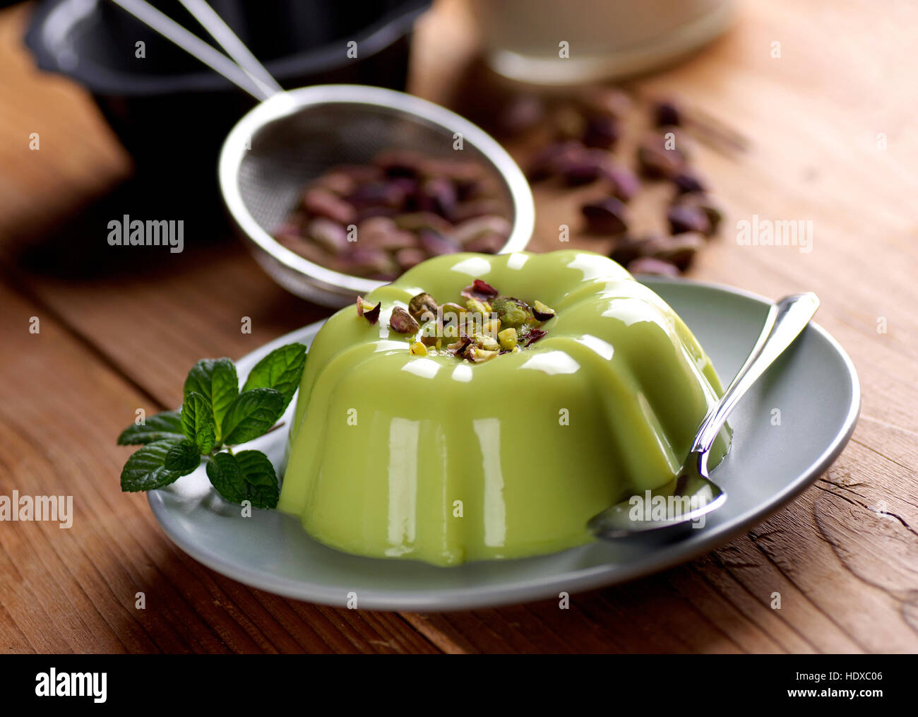 pistachio pudding with ingredients around - Stock Image