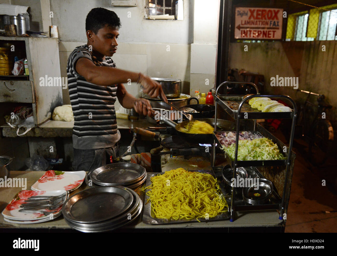 Cooking indian style chinese food in a small restaurant in jorhat cooking indian style chinese food in a small restaurant in jorhat assam forumfinder Choice Image