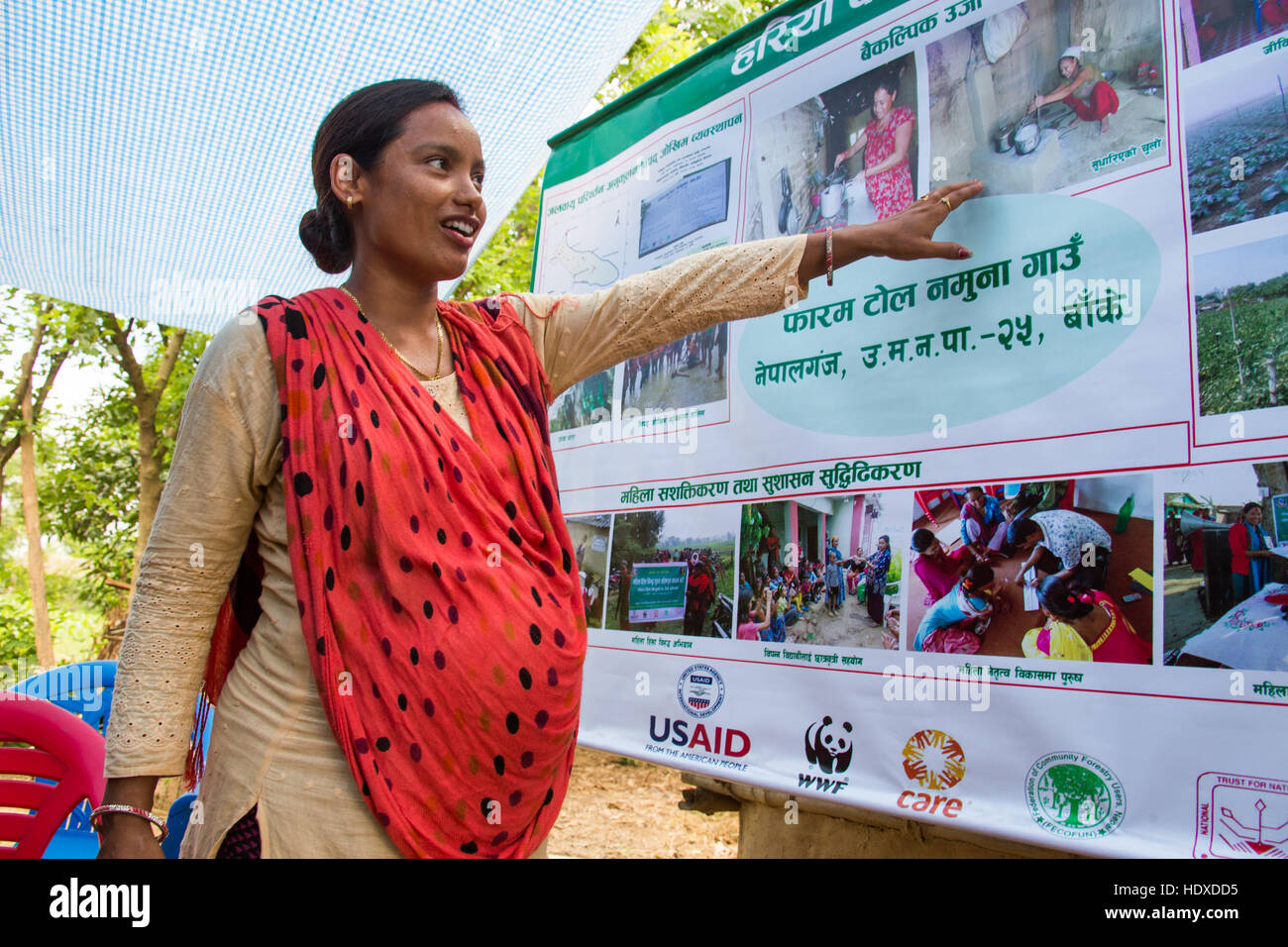 Young local woman demonstrating the progress made by Hariyo Ban, a USAID funded NGO in the Terai, Nepal - Stock Image