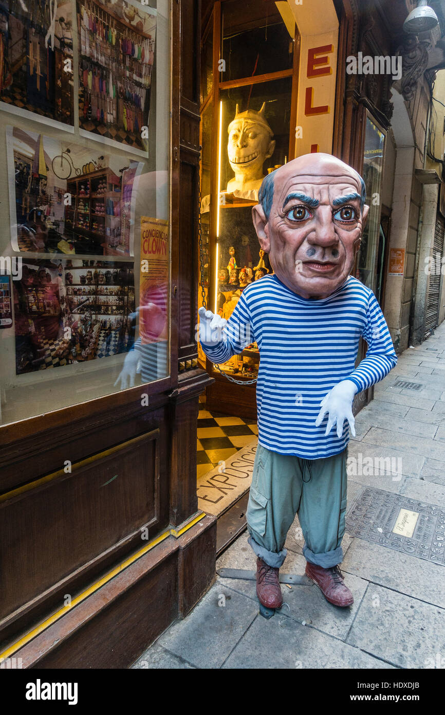 A person standing in front of a store front wearing a Picasso likeness costume, including a large head, in Barcelona, - Stock Image
