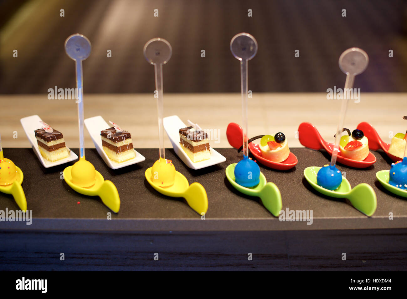 Sweet Dessert canapes sweets on restaurant table - Stock Image