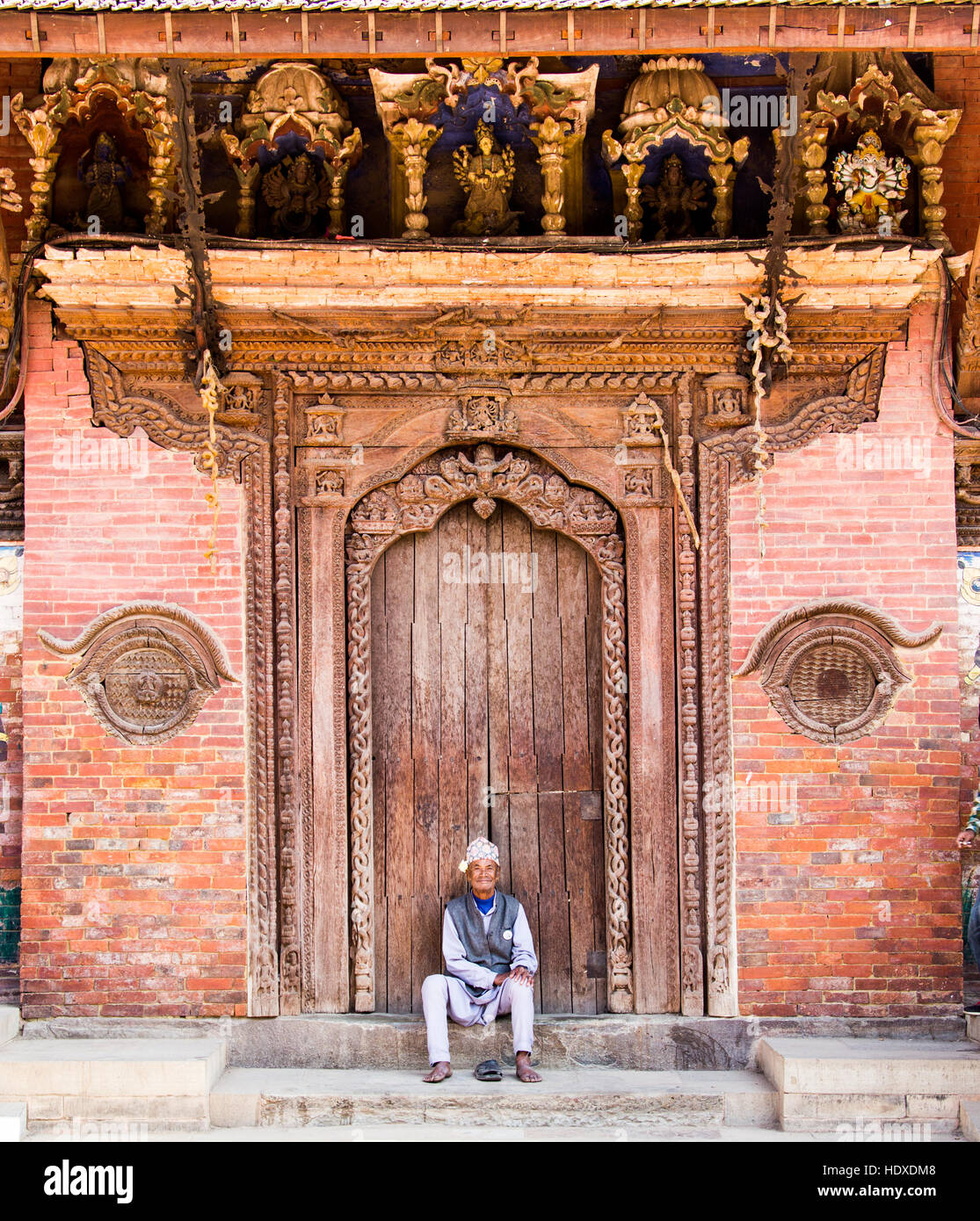 Elderly man in Patan Durbar Square, Nepal - Stock Image