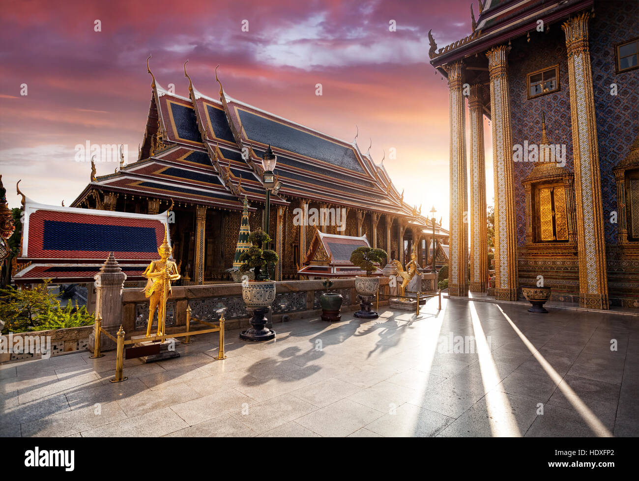 Temple of the Emerald Buddha Wat Phra Kaew in Bangkok at sunset - Stock Image