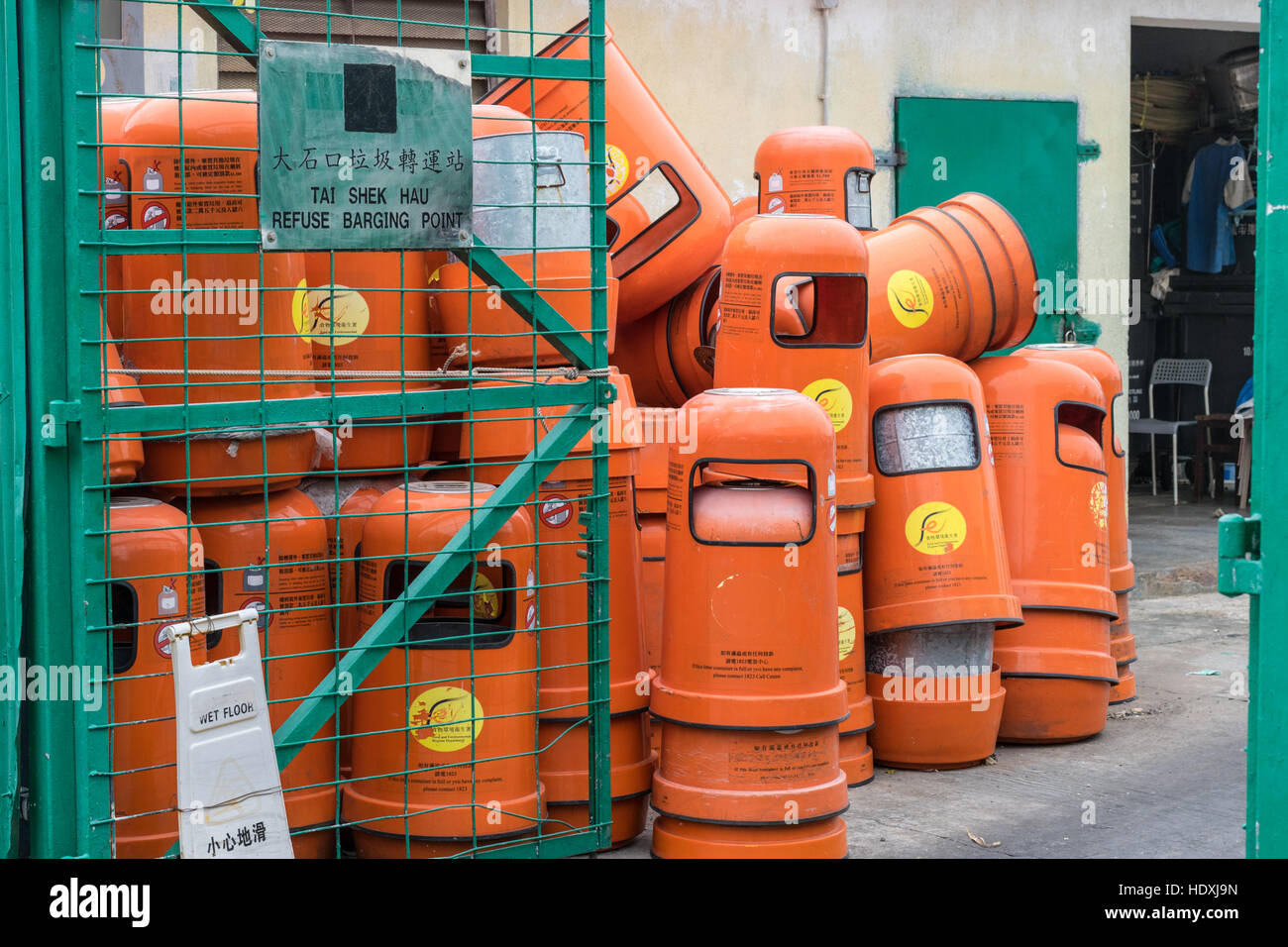 Orange rubbish bins in Hong Kong - Stock Image