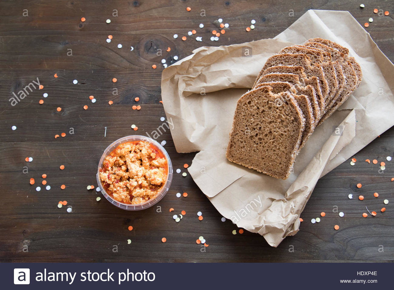 Organic food brown bag bread sliced bread bread on table bread and cheese loaf bread close up slices Wholemeal Bread - Stock Image