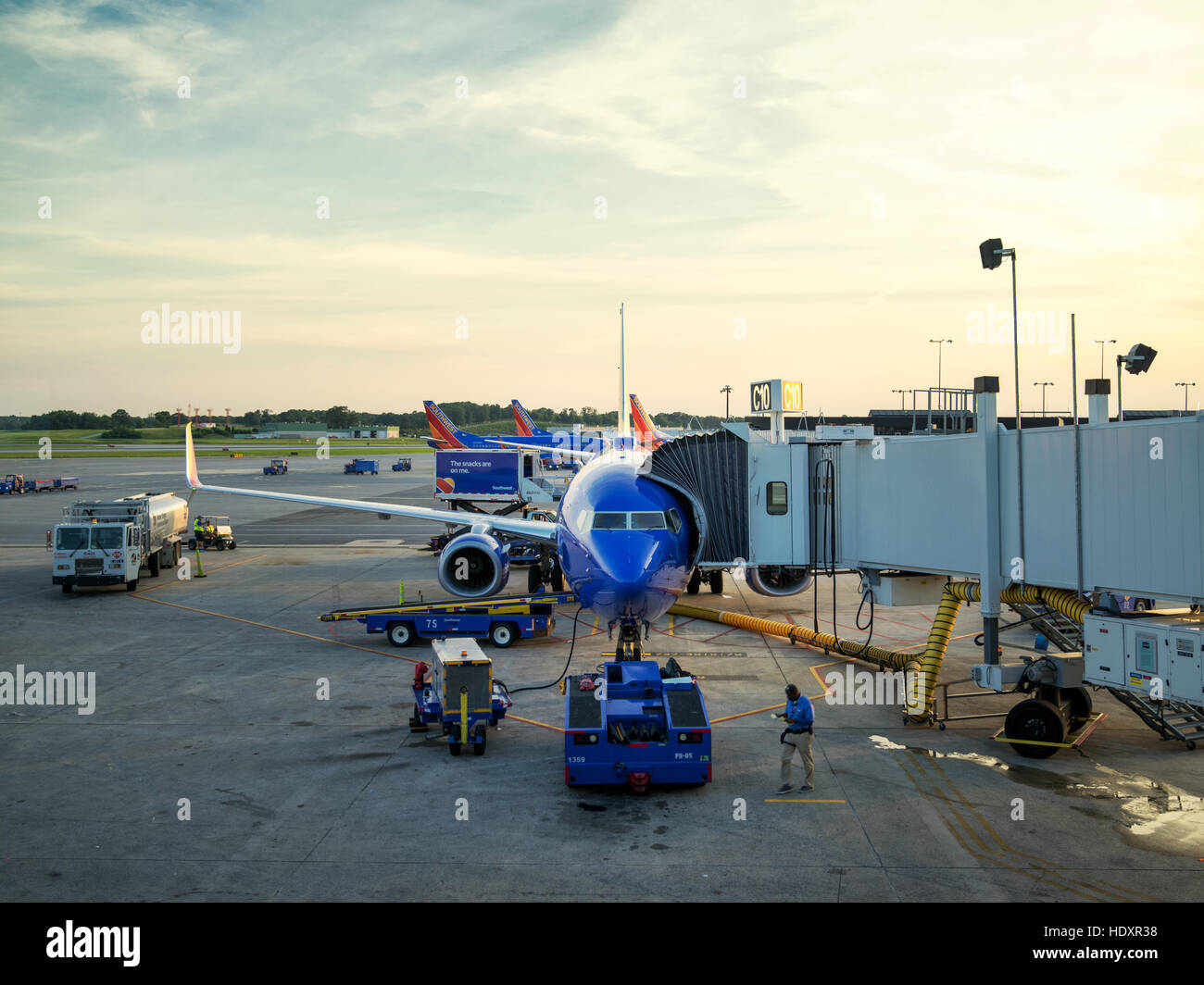 Airplane at an airport terminal gate preparing for an early flight. Baltimore Washington International, BWI. - Stock Image