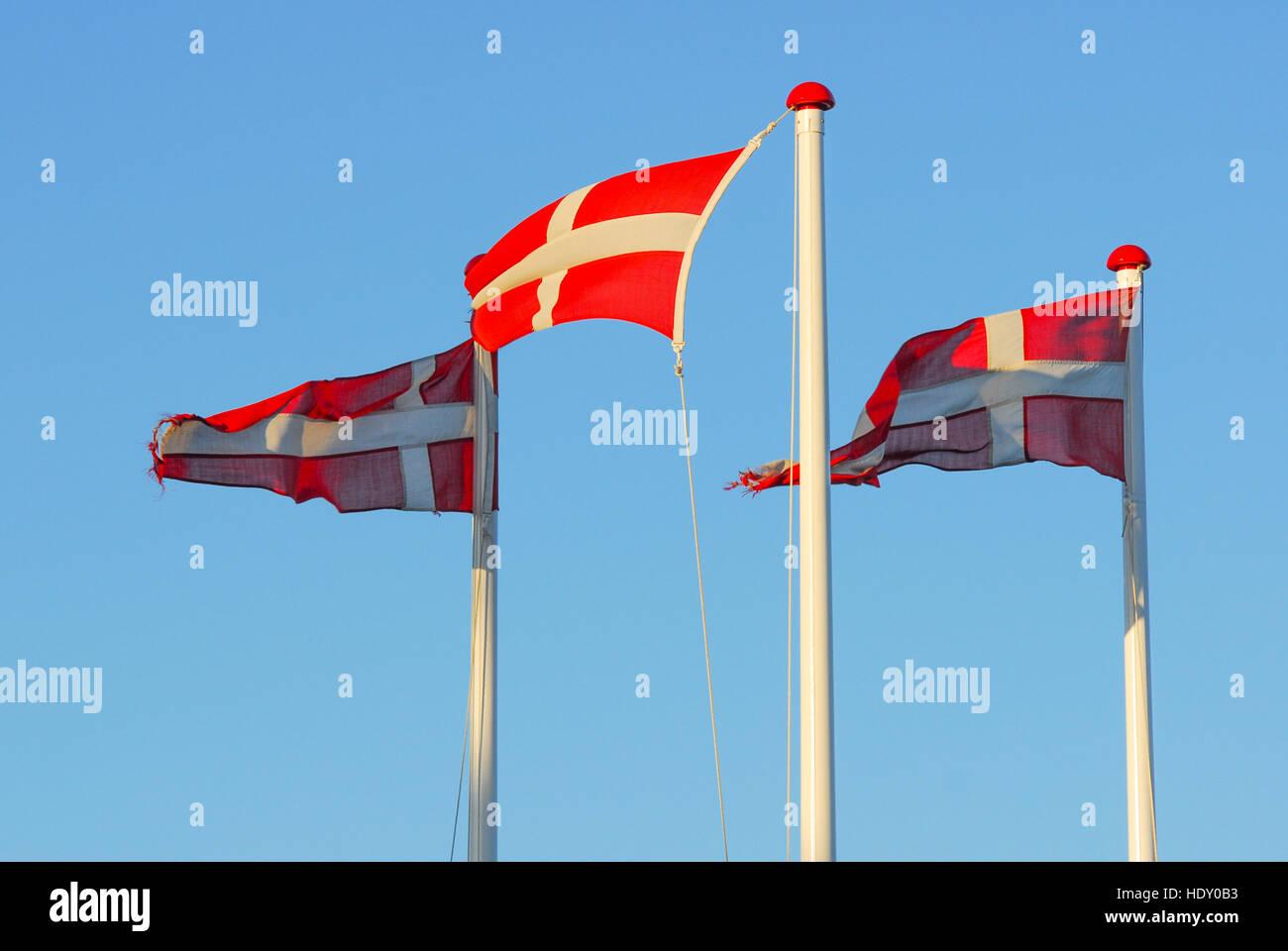 Danish Flag Dannebrog against clear blue sky - Stock Image