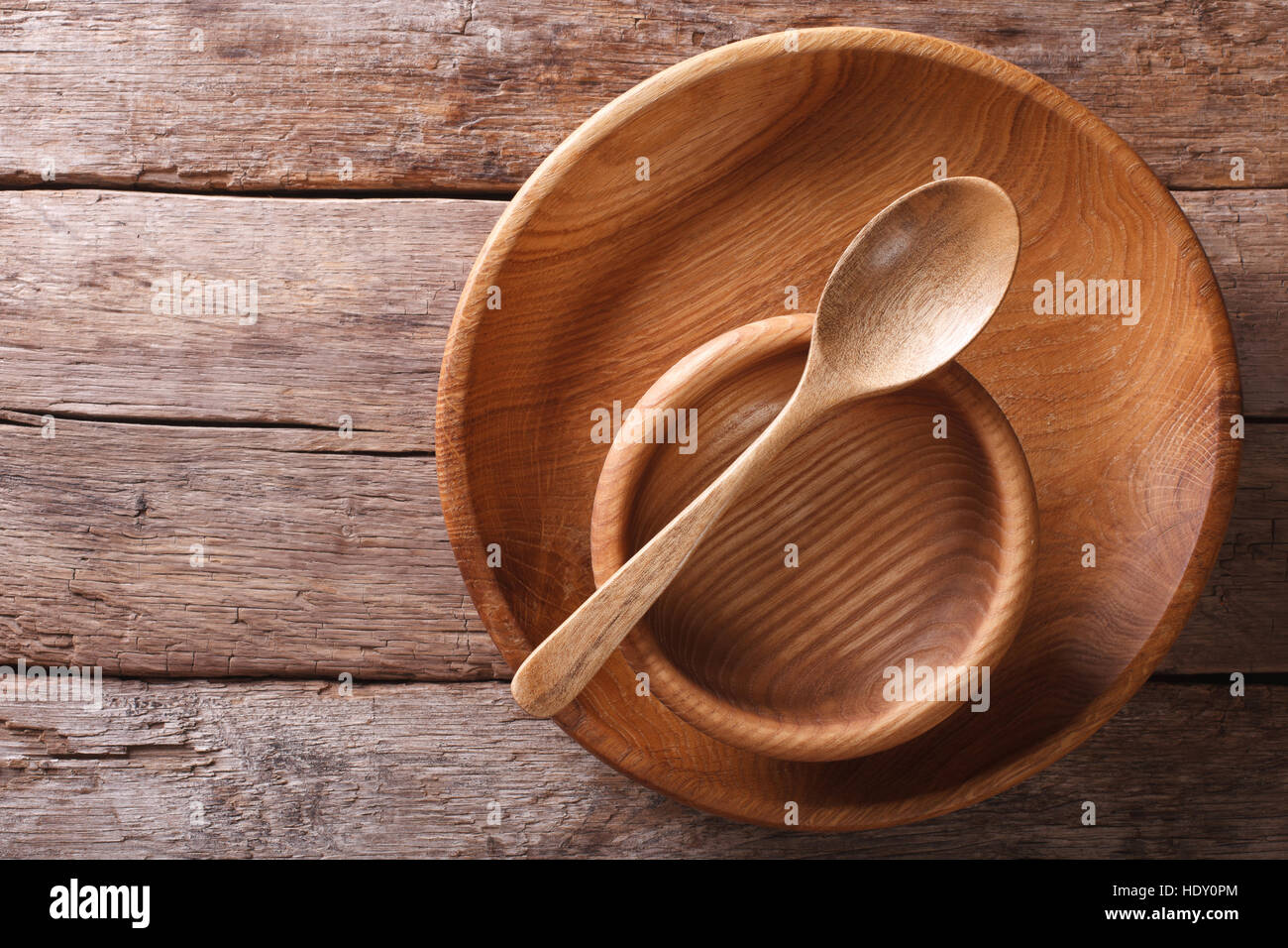 Wooden dish and spoon in a rustic style. horizontal view from above Stock Photo