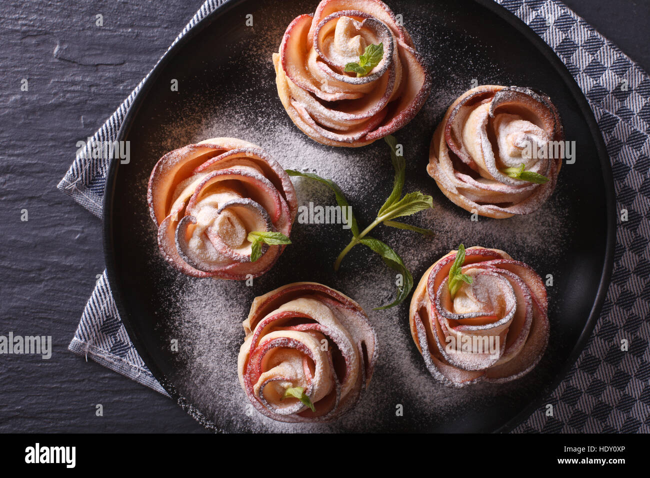 Beautiful food: apple dessert in the form of roses.horizontal top view - Stock Image
