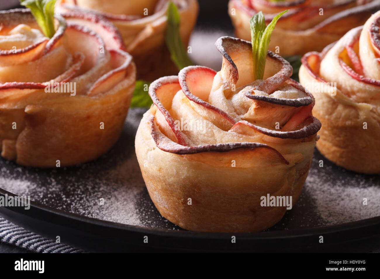 Festive pastries: Rose out of an apple closeup. horizontal - Stock Image