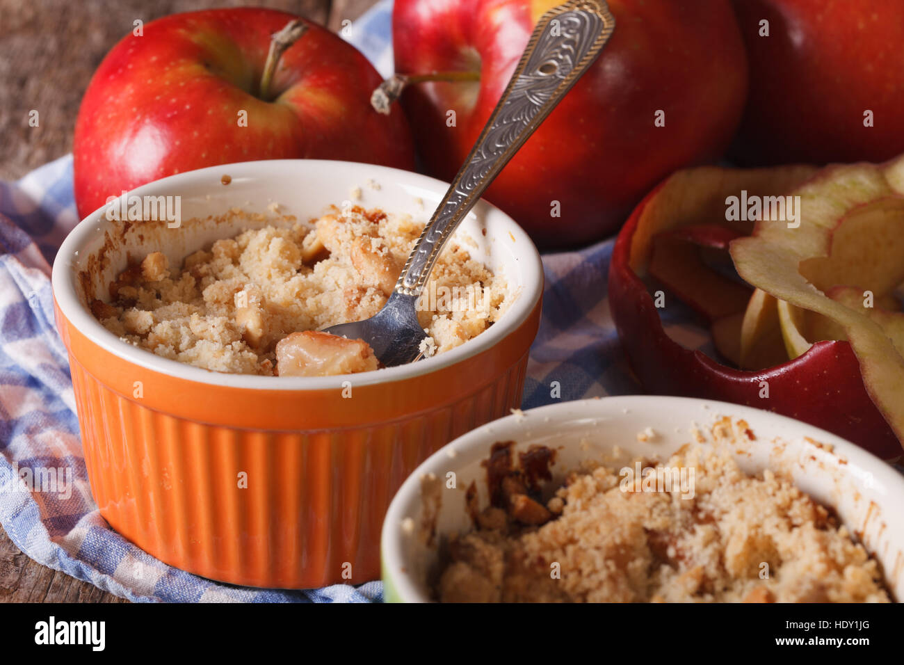 English crumble with apples close-up in the pot. Horizontal rustic style - Stock Image