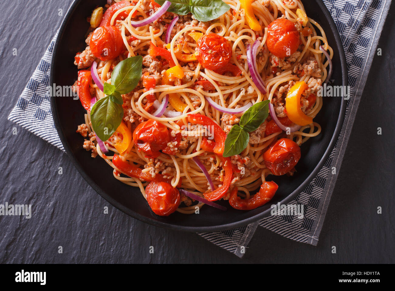 Italian food: pasta with minced meat and vegetables close-up. Horizontal top view - Stock Image