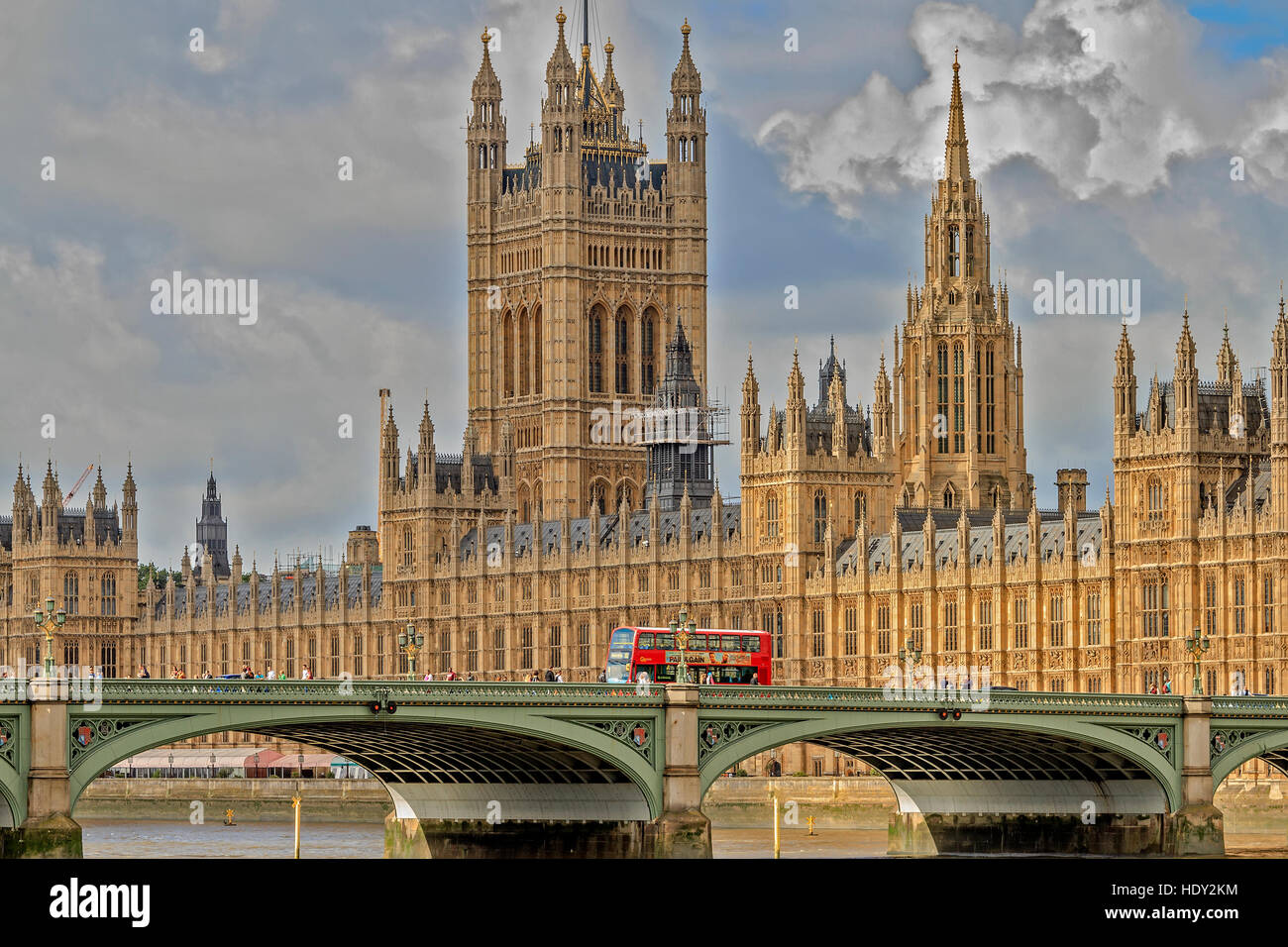 Red Bus Crossing Westminster Bridge London UK - Stock Image