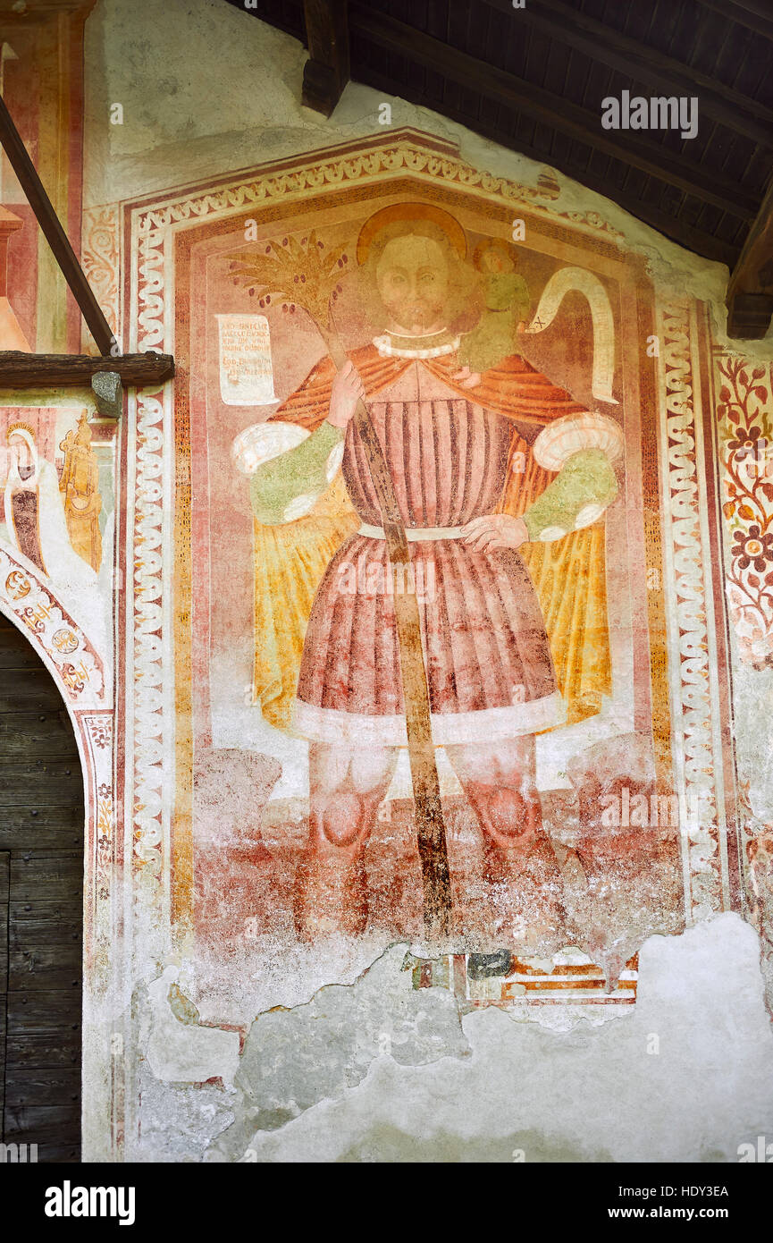 Religious mural of St Christopher with Christ on his shoulders by Dionislo Baschenis, dated 1493, on the exterior - Stock Image