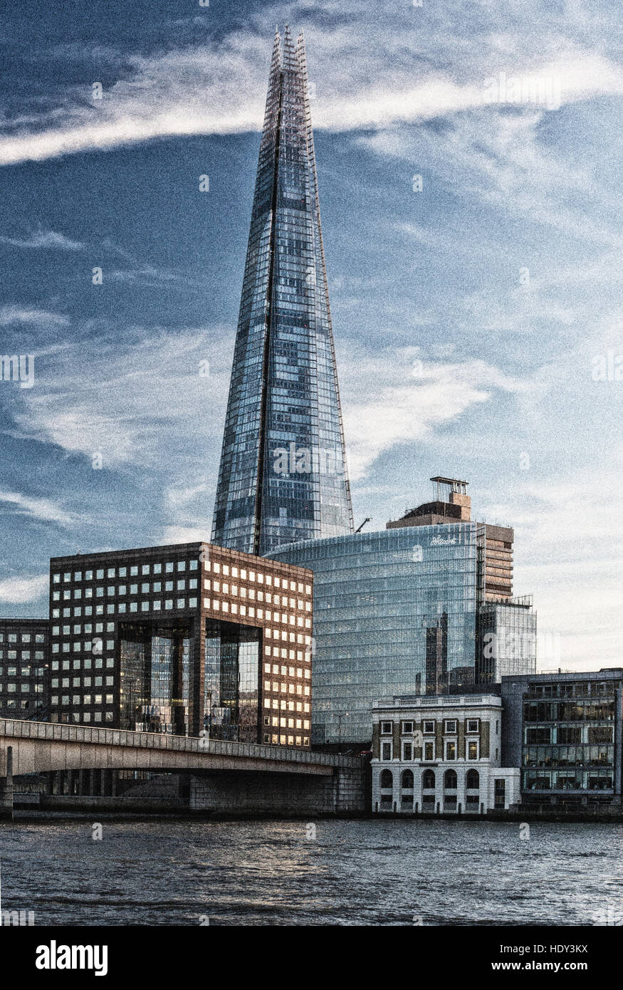 London's Shard photographed at sunset from the northside of the  river Thames and showing London Bridge - Stock Image