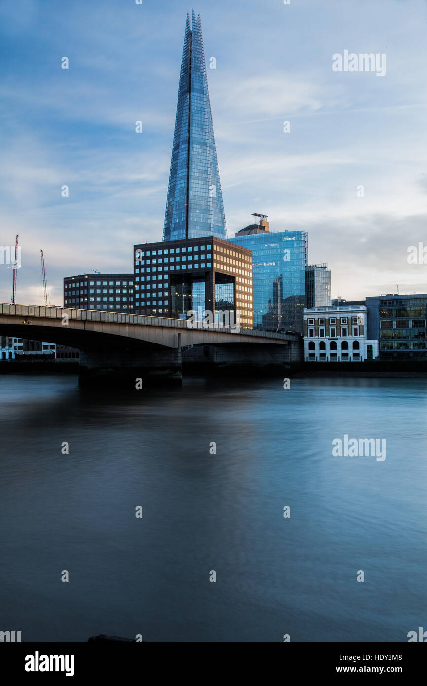 London's Shard photographed at sunset from the northside of the  river Thames and showing London Bridge Stock Photo