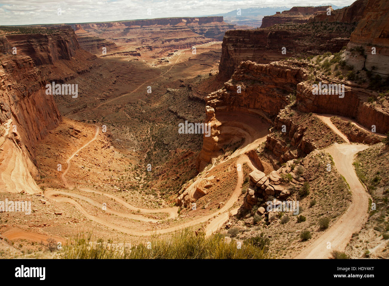 Shafer train winding road as it descends 18 miles and several thousand feet to the White rim trail of Canyonland - Stock Image
